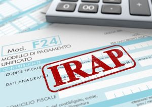 38591346 - close up view of f24 form for italian taxes,the word irap and an electronic calculator (3d render)